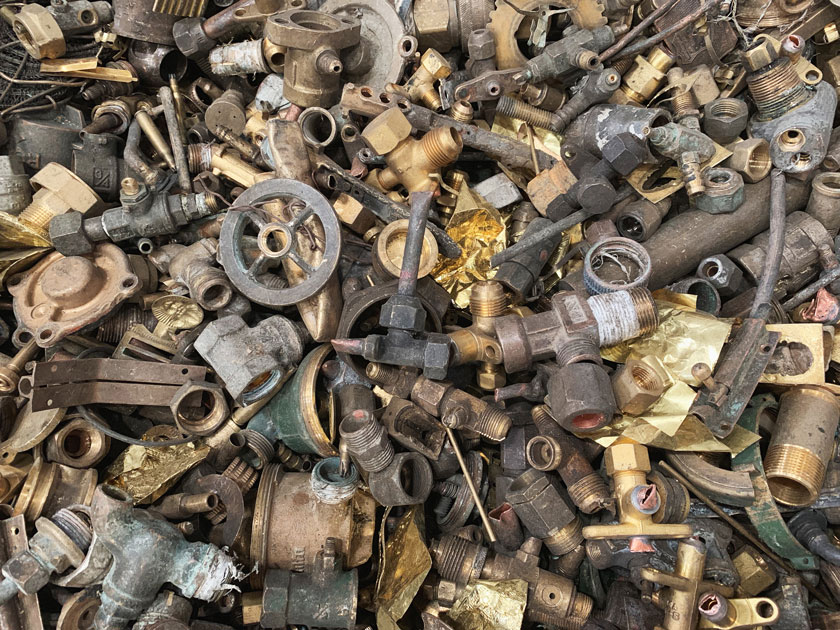 Close up used brass scrap are non ferrous metal raw materials for the recycling smelting manufactures. Waste metal can be reproducing in the recycle industries. Brass scrap background.